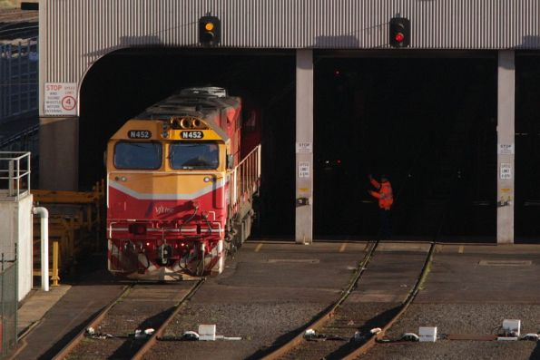 N452 shunts a carriage set into the shed at West Melbourne