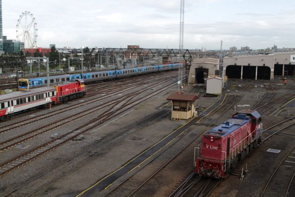 P17 heads light engine over to the sidings at West Melbourne depot, as an empty push-pull set departs Southern Cross