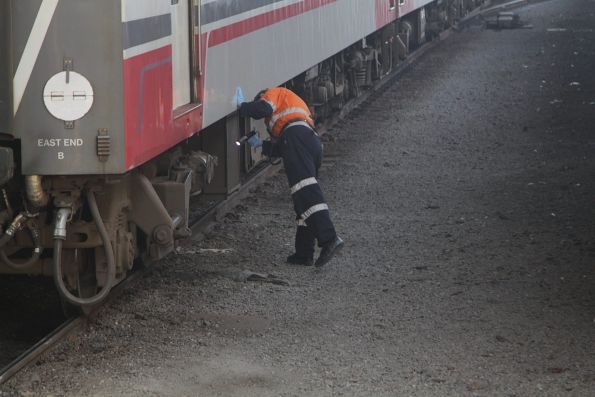 Shunter inspects the brakes of an N set before departure from Southern Cross