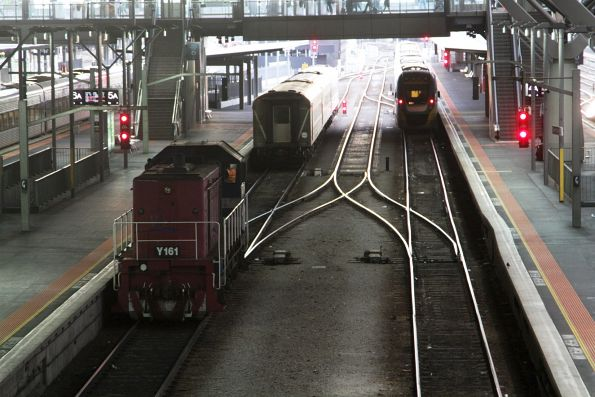 Y161 shunts a carriage set into the platform at Southern Cross