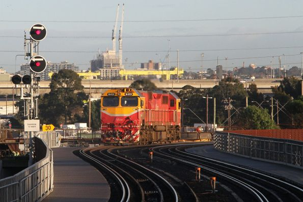N453 heads light engine over the North Melbourne flyover bound for Melbourne Yard