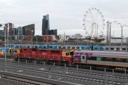 N467 leads PTV liveried carriage set N11 out of the Melbourne Yard sidings
