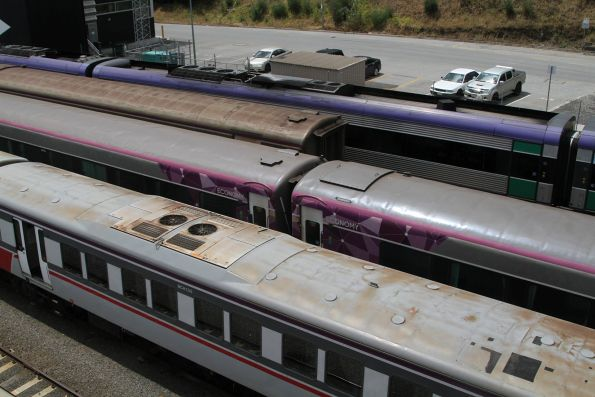 Carriages in V/Line Mk3 livery beside the new PTV livery