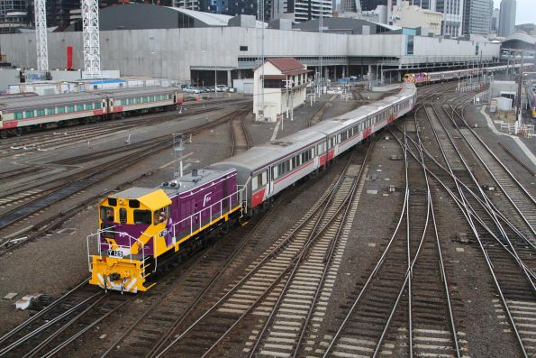 Y129 shunts a H set towards the platform at Southern Cross