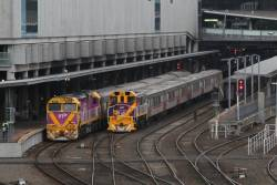Two PTV livered locomotive next to each other at Southern Cross