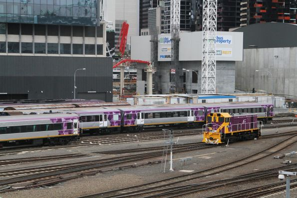 Y129 stabled beside PTV repainted carriage set SH34 at Southern Cross Station