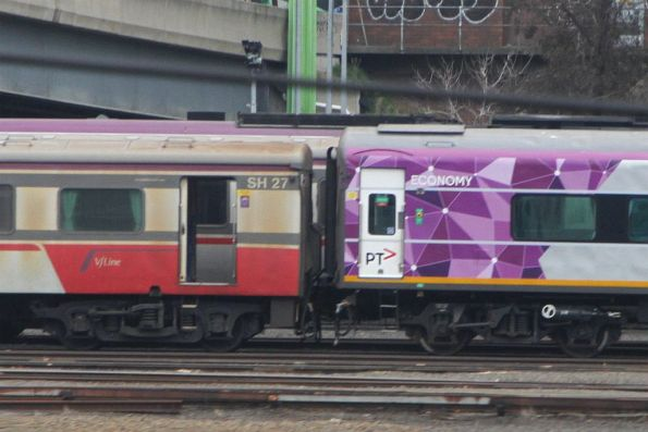PTV liveried N set coupled up to V/Line Mk3 liveried carriage set SH27 at Dudley Street