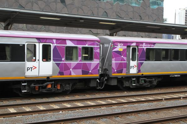 PTV liveried carriage sets LH33 and SH34 at Southern Cross platform 3