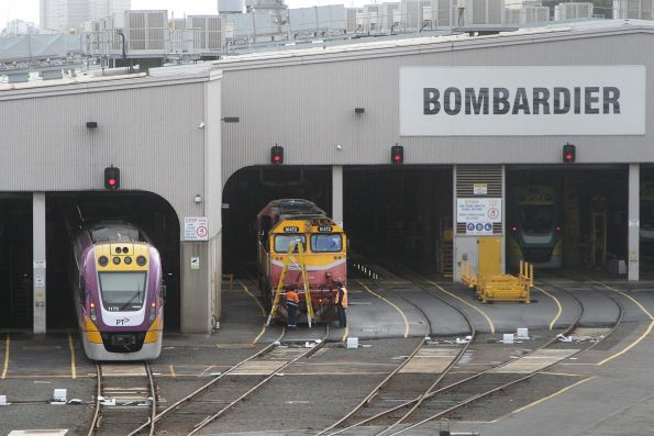 Cab of N472 gets some attention at Dudley Street, with VLocity VL70 alongside
