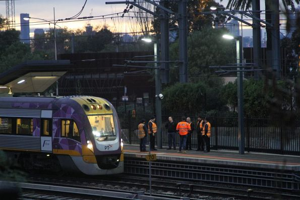 V/Line staff with VLocity VL07 stopped at the 9-car mark at Footscray