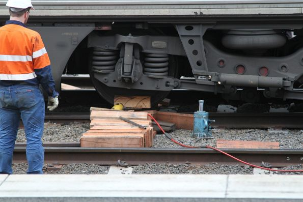 Using timber blocks and jacks to get the bogie back on the rails