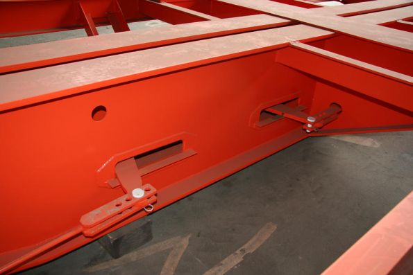 Brake rigging beneath a skeletal container wagon