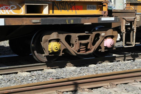 Yellow and pink painted axle box bearing covers