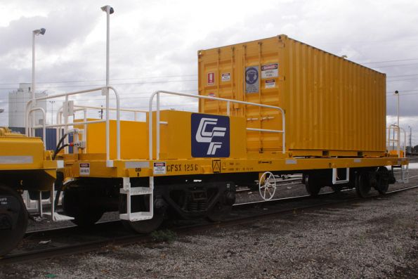 CFSX 125G: a former sleeper discharge wagon (on a VLCX underframe) fitted with lighting, handrails, and a container mounted genset to run everything