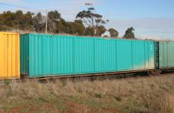 Toll 53' car container on a RRYY 5 pack articulated skeletal deck wagon