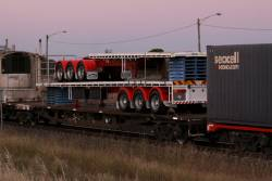 Flatbed A and B trailers for a B-double loaded on the westbound SCT train