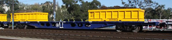CQOY 2197Y with loaded spoil containers on a Metro works train