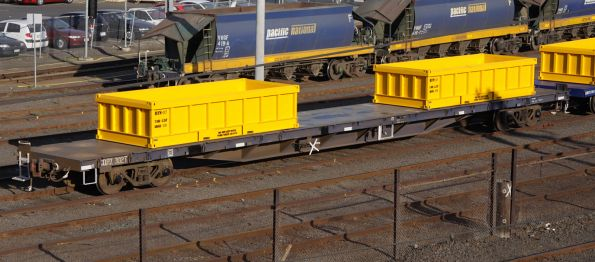 CQRX 302T fitted with new spoil containers for MTM suburban works trains