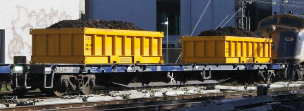 CQRX 304Y with loaded spoil containers on a Metro works train