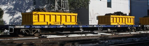 CQRX 303 with loaded spoil containers on a Metro works train