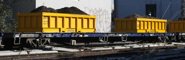 CQRX 317D with loaded spoil containers on a Metro works train