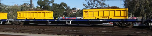 CQRX 306J with loaded spoil containers on a Metro works train