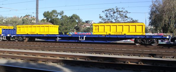 CQRX 302 with loaded spoil containers on a Metro works train