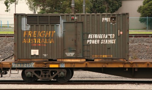 Genset container PP01 at Tottenham on a PN broad gauge train