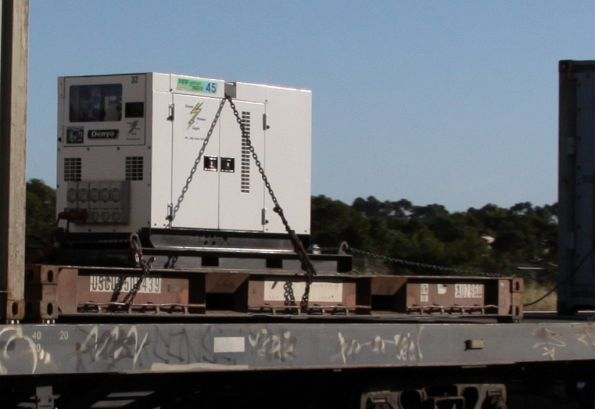 Rental genset strapped to a flatrack on POTA's MA2 service