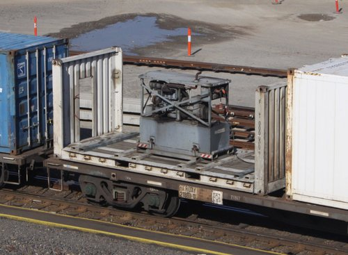 One of three gensets on Patrick's MA3/AM3 service - strapped to a 20 foot flat rack