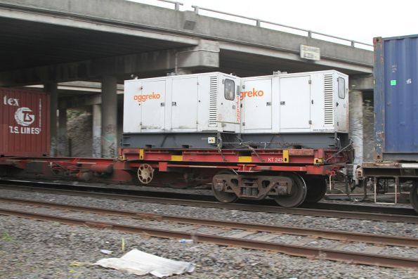 Pair of Aggreko gensets tied down to a 20 foot flatrack to power containers on the SCT Dooen freight