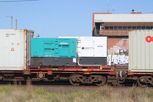 Pair of Perkins gensets tied down to a 20 foot flatrack to power containers on the SCT Dooen freight