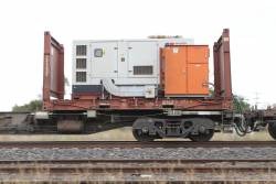 Onsite MTU rental genset atop a flatrack container loaded on a Qube LQAY wagon