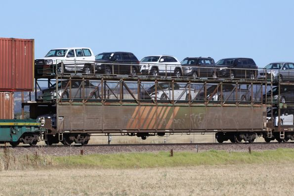 Triple deck car carrier RMKY 1821L loaded with new cars on a westbound Pacific National freight outside Adelaide