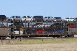 Triple deck car carrier RMGY 1801G loaded with new cars on a westbound Pacific National freight outside Adelaide