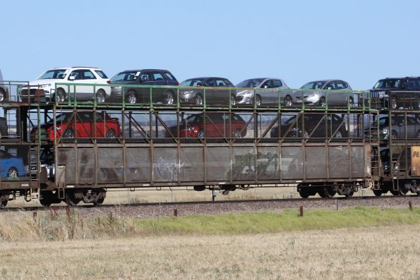 Triple deck car carrier RMKY 1827T loaded with new cars on a westbound Pacific National freight outside Adelaide