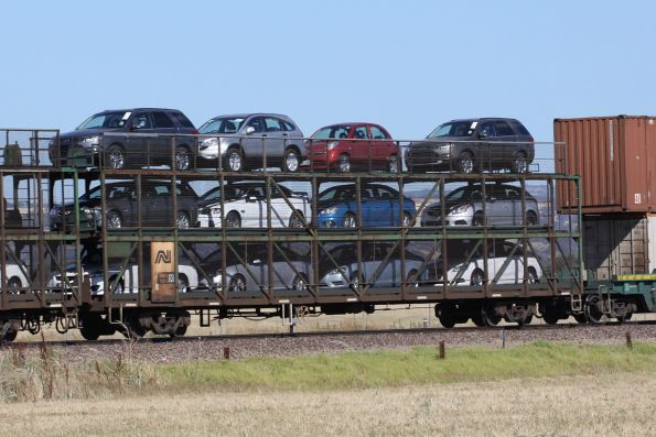 Triple deck car carrier RMDY 3139K loaded with new cars on a westbound Pacific National freight outside Adelaide