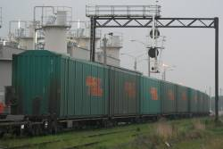 A number of RRYY 5-pack wagons loaded with Toll car containers