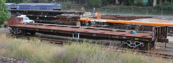 GFLX (?) flat wagon with bulkheads at the Creek Sidings