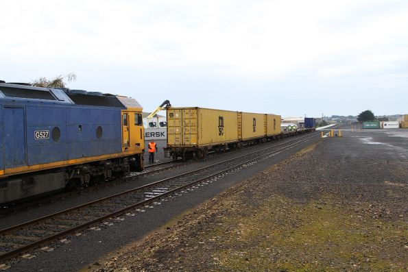 G527 brings half of the train back into the container terminal, ready to push the rear half out