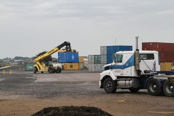 Reach stacker unloads containers from the train