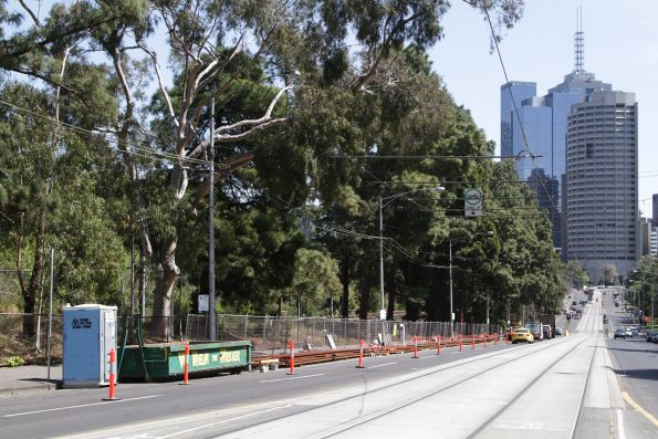 New lengths of rail sit alongside Wellington Parade at Jolimont station