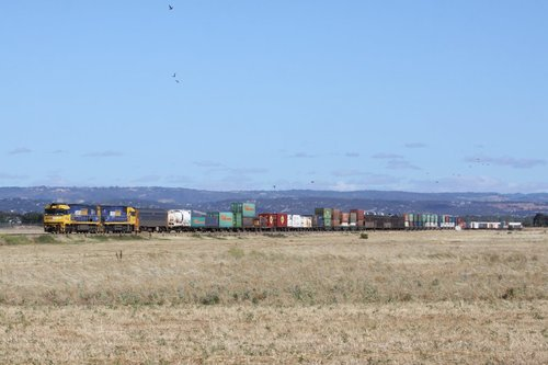 Double stacked PN freight heads west out of Adelaide near Bolivar