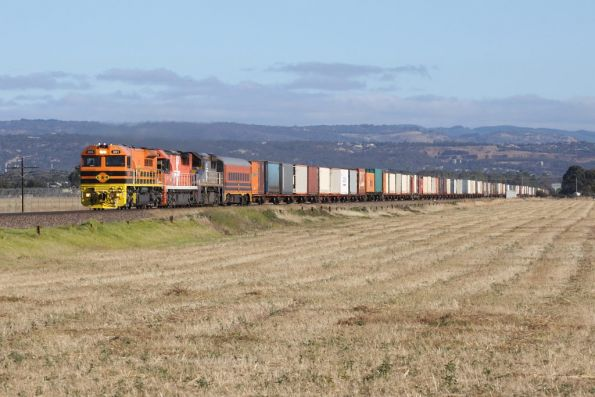 GWA001 leads FQ03 and VL353 on a northbound Darwin service out of Adelaide at Bolivar