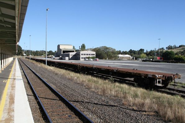 Pacific National container wagons stored in the siding at Blayney