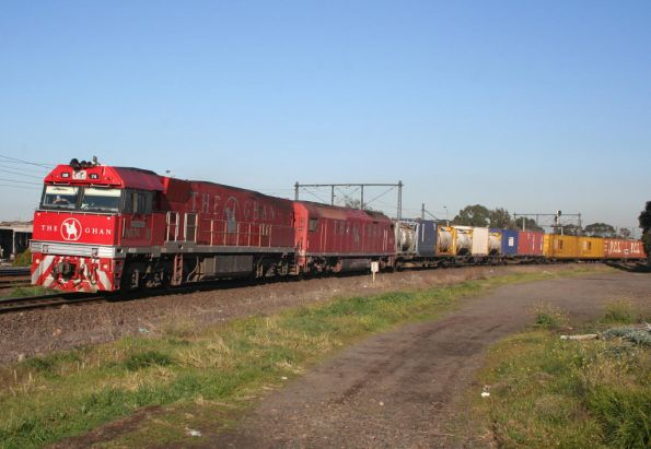 Finally - Ghan liveried pair NR74 and AN3 on AM5 up freight at Newport