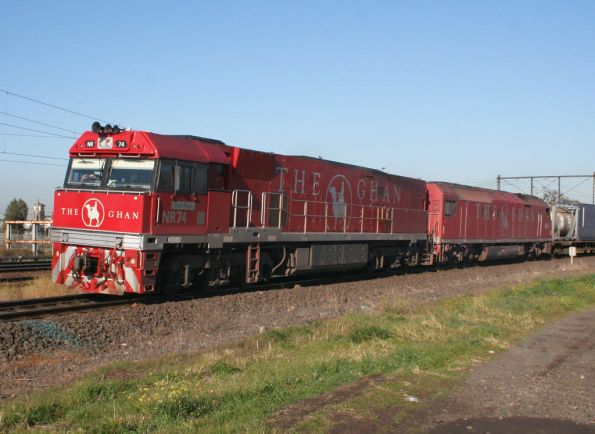 Ghan liveried pair NR74 and AN3 on AM5 up freight at Newport