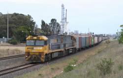 NR1 in PN livery leads NR100 through Corio on the up