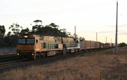 New and old green liveries- Trailerail NR55 and Southern Spirit NR85 on a Melbourne bound PM6 freight at Werribee