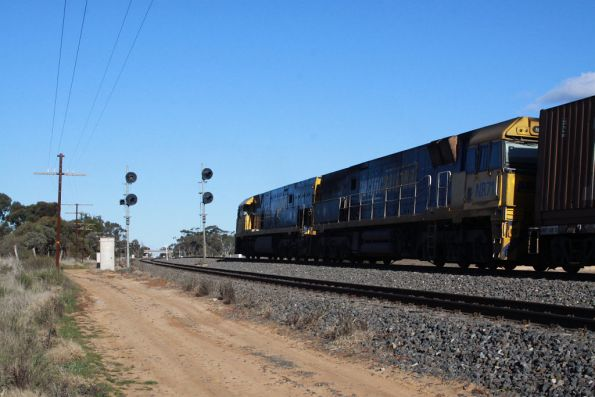 NR54 and NR71 wait on the main line at Dimboola Loop on PM5 - XR559 was attached in Dimboola itself for the trip east